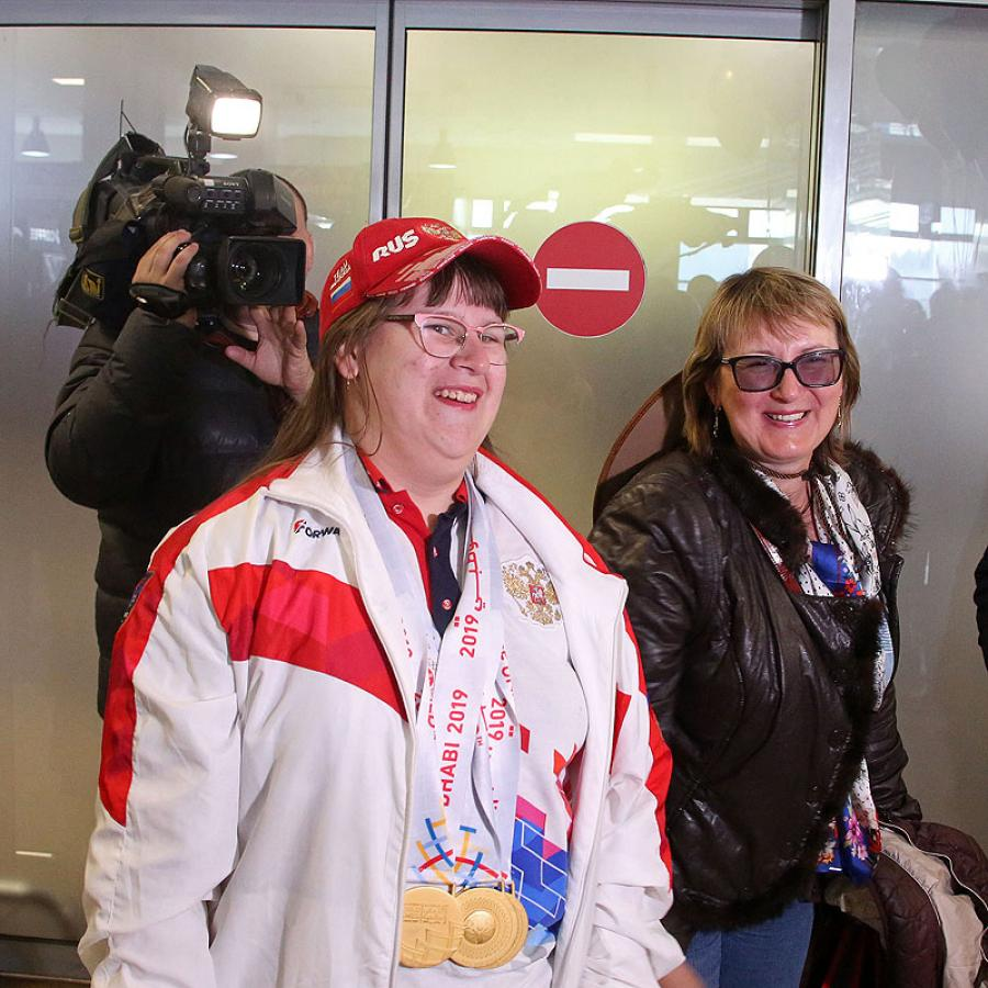 Встреча в аэропорту победителей Всемирных летних игр Специальной Олимпиады
