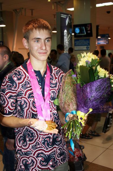 Вот они - две медали: «серебро» в составе сборной по фехтованию на саблях и «золото» в личном турнире.